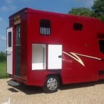 Red Horsebox with White Graphics