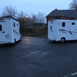 Two White Horseboxes Outside