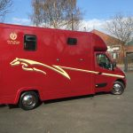 Red Horsebox with Yellow Graphics